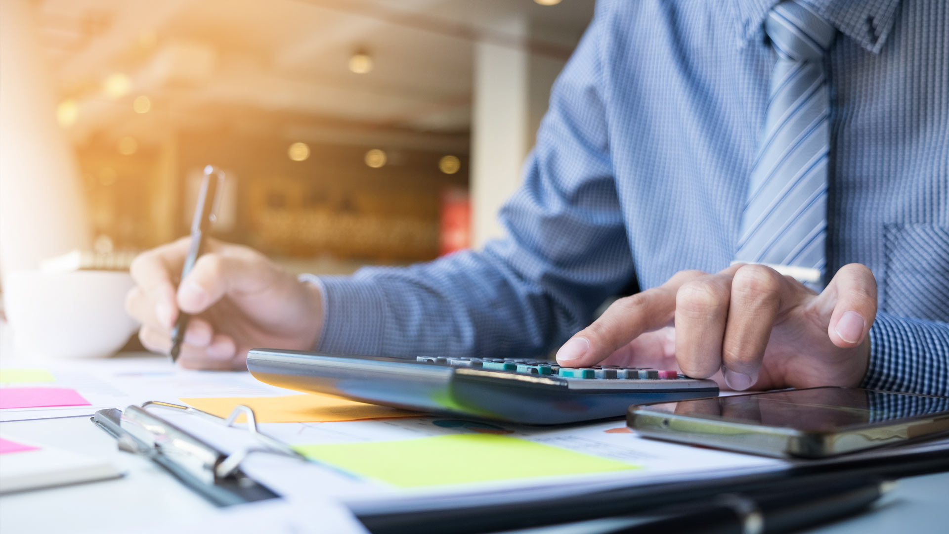 Business-finance-man-calculating-budget-numbers-Invoices-and-financial-adviser-working.jpg